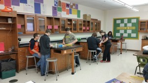 Four other students working on bridges