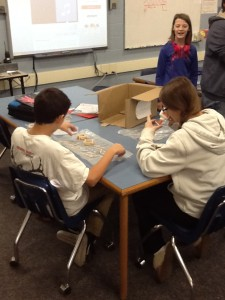 Two students piecing together toothpicks