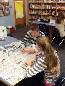 Two other students gluing their bridges together